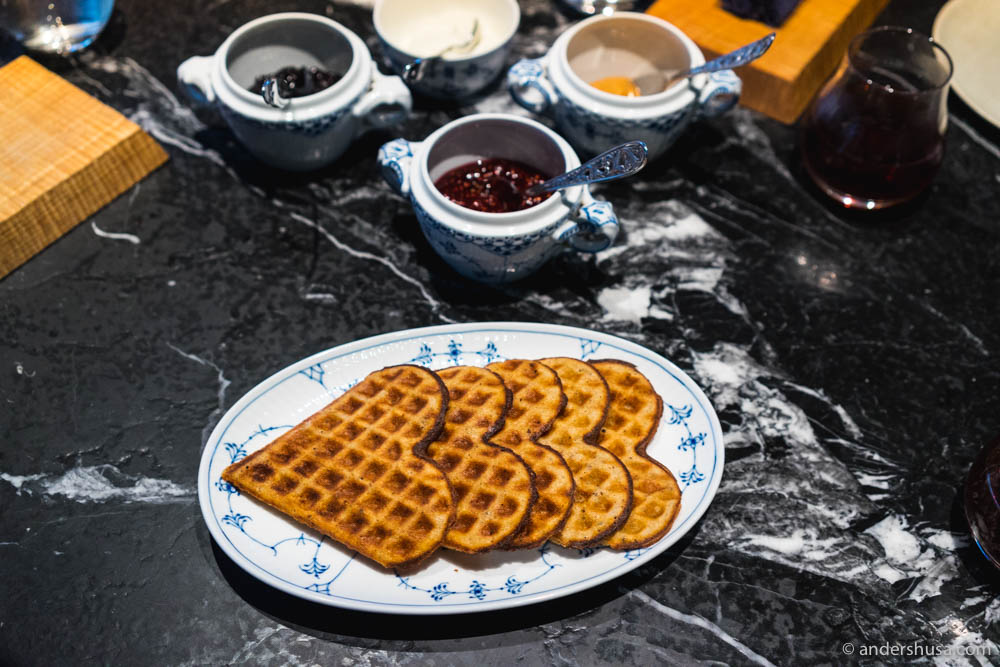 Norwegian waffles made with beef fat and koji grains, brown cheese spread, preserved berries, and whipped sour cream