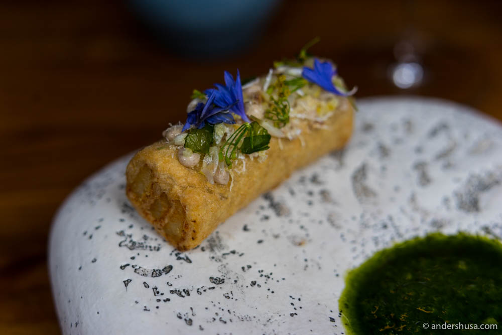 Deep-fried puff pastry with stockfish, söl mayo, fermented lemon zest, cornflower, and sea lettuce at Araktaka.