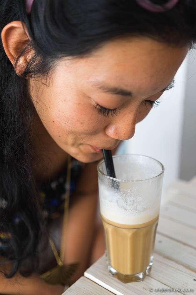 Louise enjoys a latte