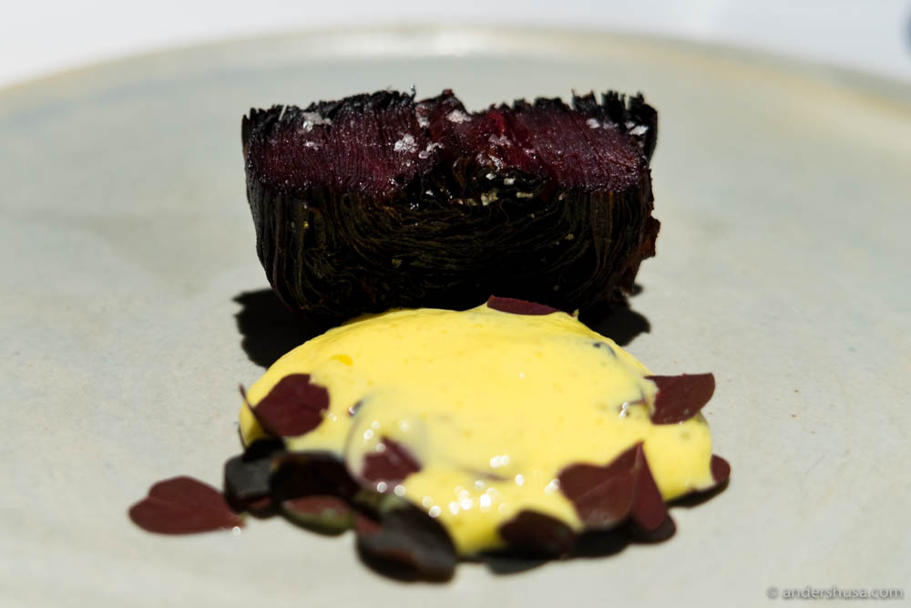 Purple carrot roll, with foamy hollandaise and oxalis by Christian Puglisi
