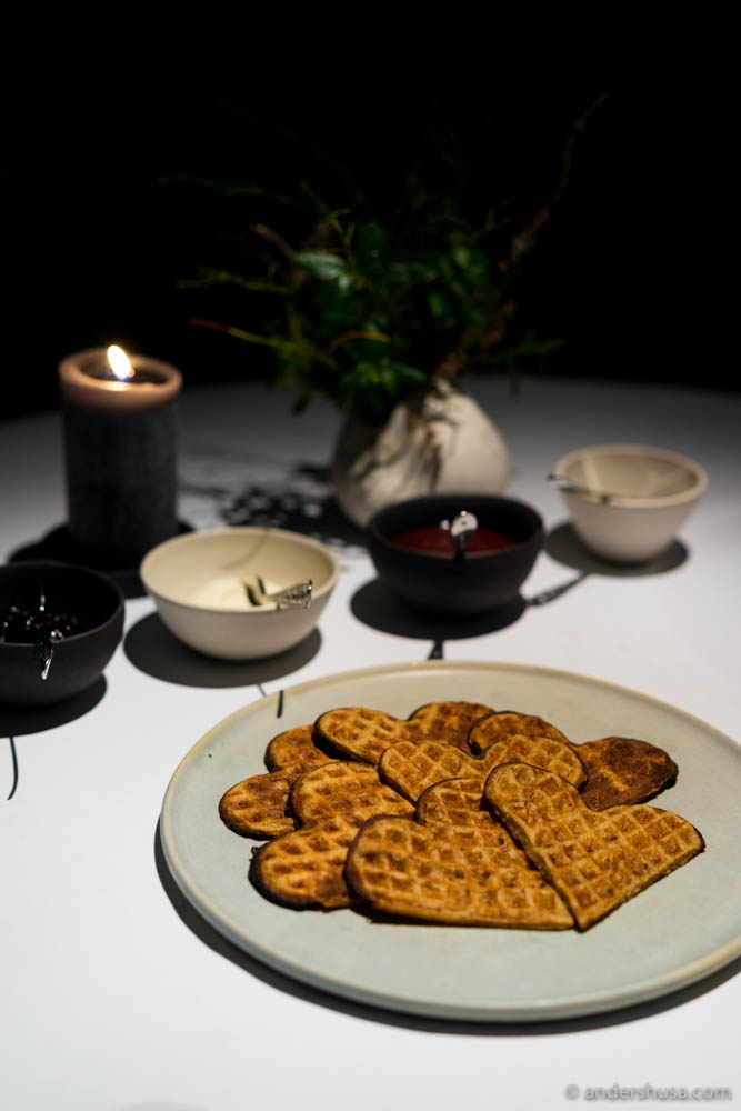 Warm Norwegian waffles á la Maaemo, made with beef fat and koji grains, served with brown cheese spread, preserved berries, and whipped sour cream