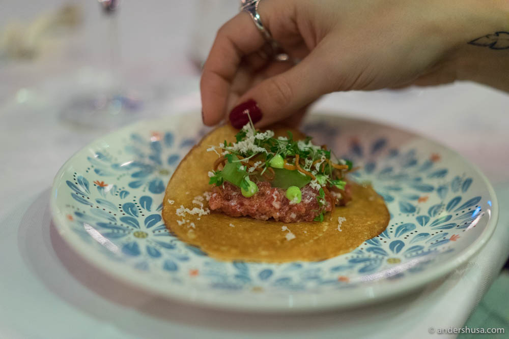 """Horse tartare, """"løyrom,"""" pickled cucumbers, smoked tarragon mayo, horseradish, and cress served in a pancake"""
