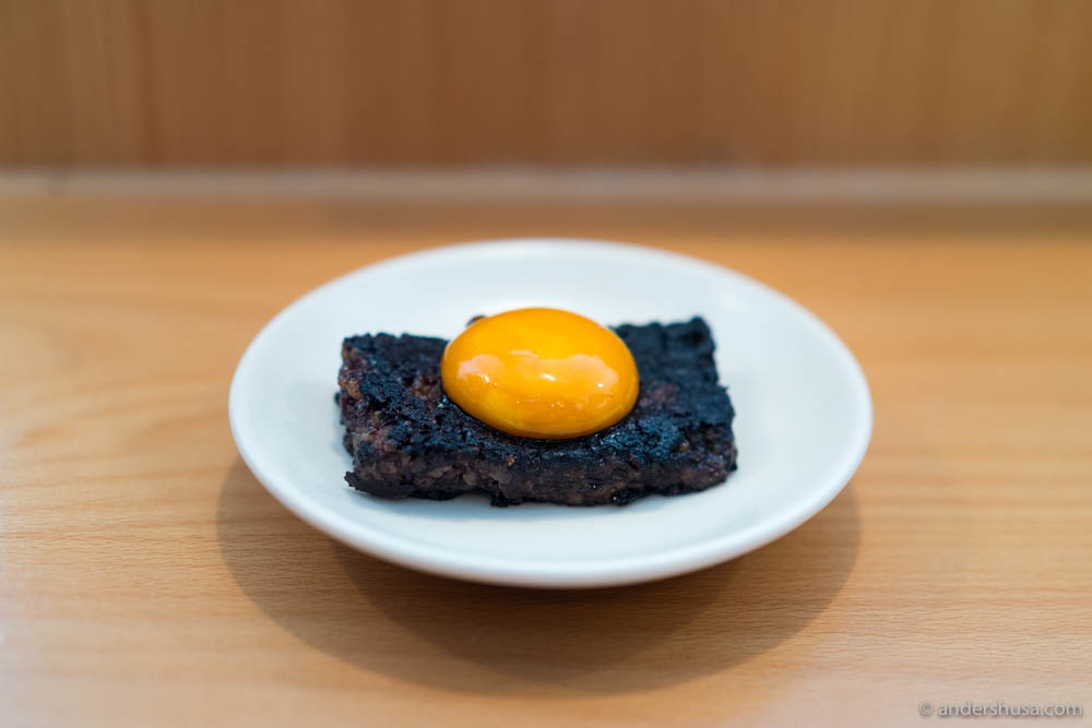 Pig blood cake with egg yolk