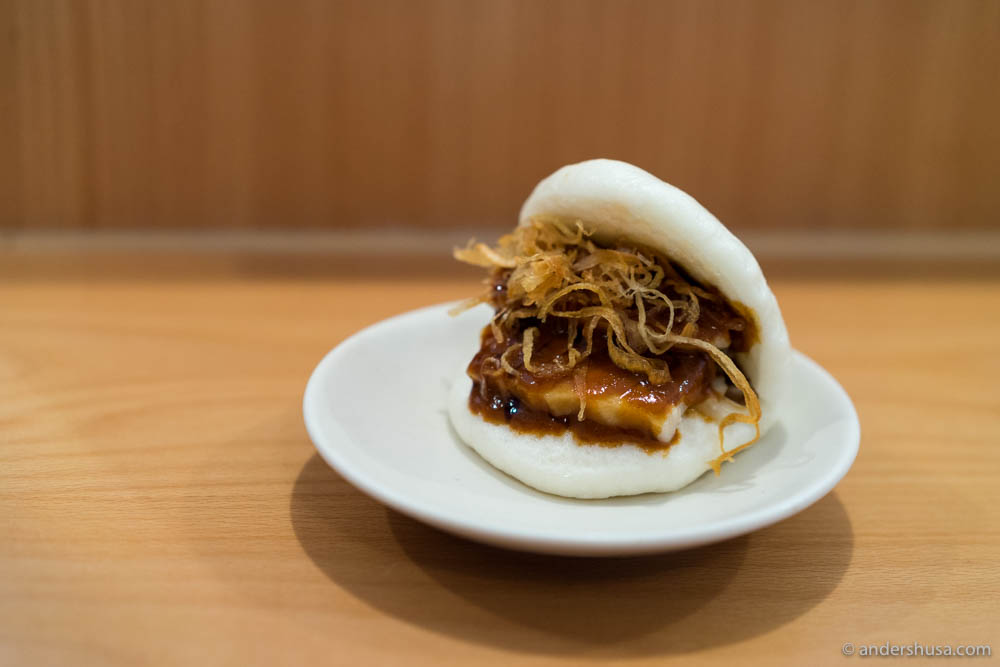 Confit pork belly bao with hot pork sauce & dried shallots