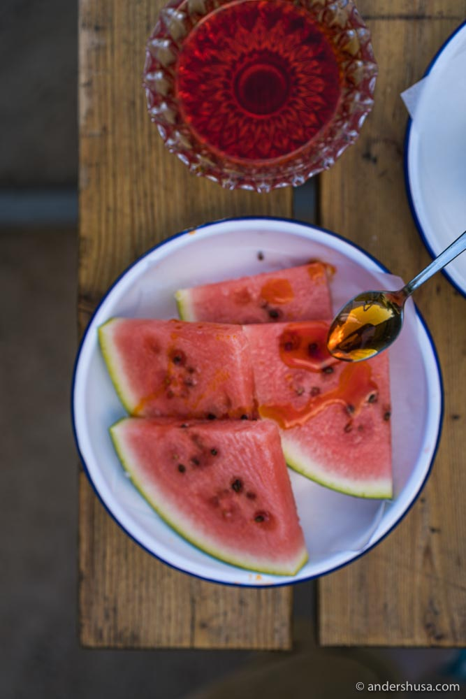 Slices of watermelon with hot chili oil and sea salt.