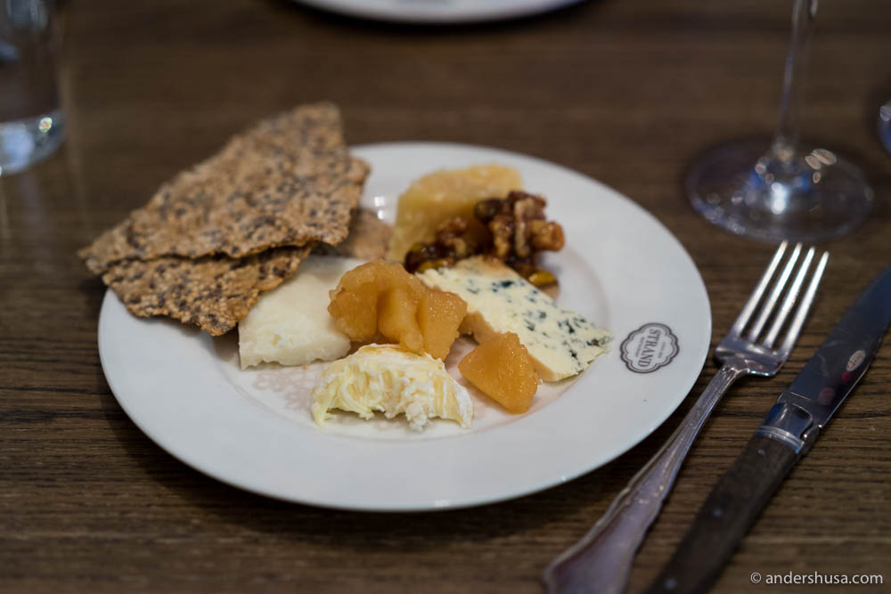 Selection of Norwegian farm-produced cheeses with quince compote and flatbread
