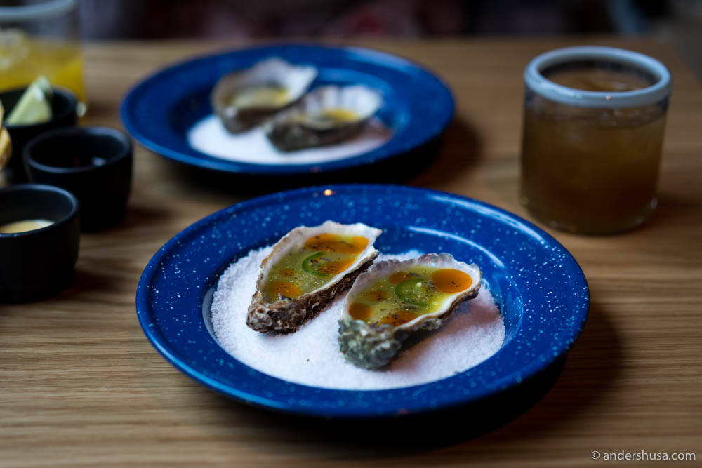 Oysters with cucumber, jalapeño, daikon & chili oil