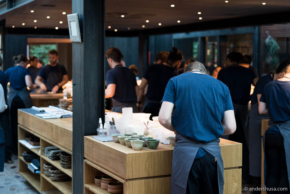 Chefs hard at work in the open kitchen of Noma
