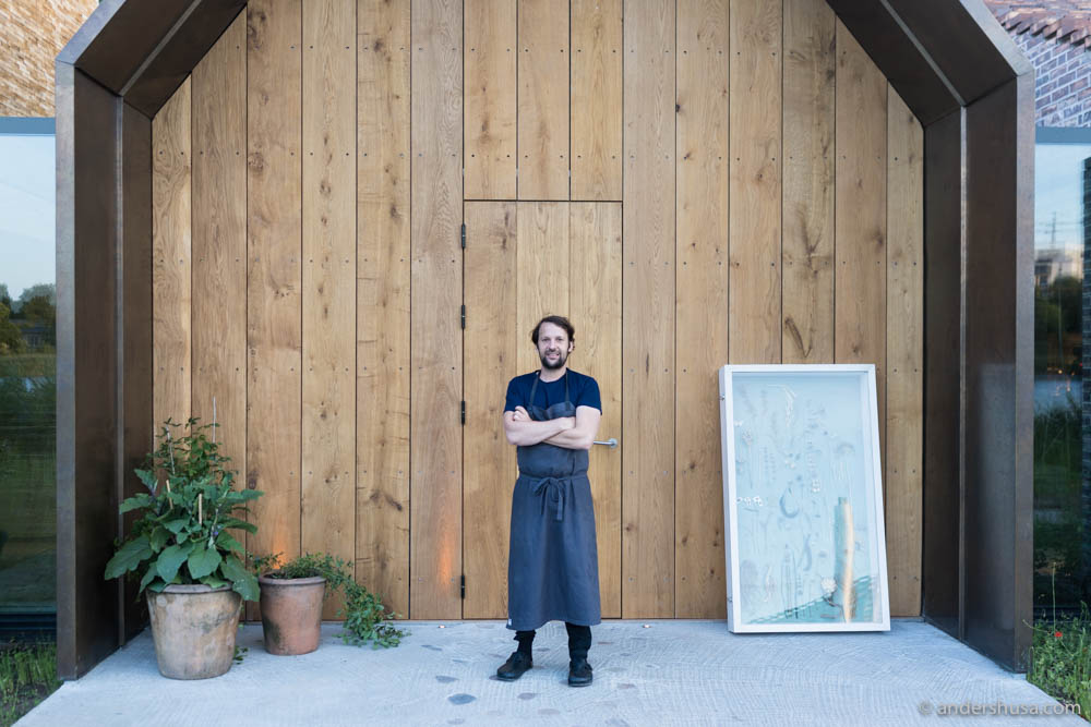 René Redzepi in front of the entrance to Noma
