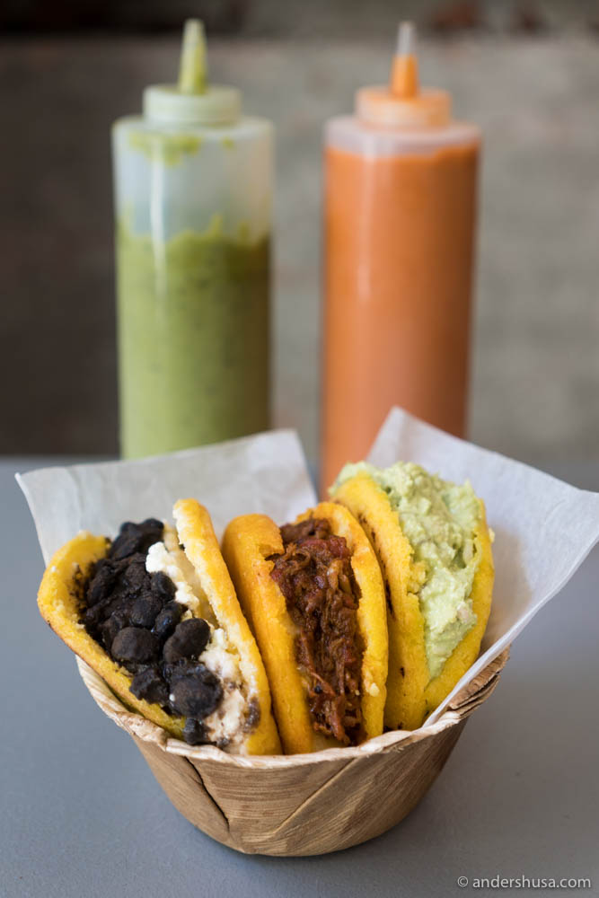 Three types of arepas! Left to right: La Dominó (black beans & fresh cheese), La Mechada (shredded beef & cheese) & La Pepiada (shredded chicken & avocado mayo)