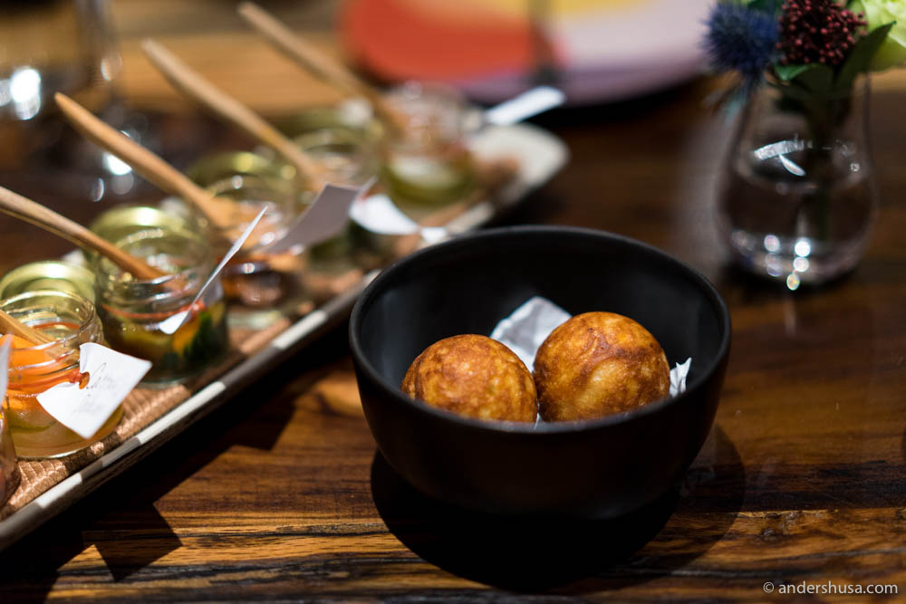 Duck vindaloo inside a puffed pancake (æbleskive) with a selection of pickles