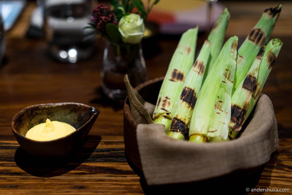 Grilled baby corn husks with a corn and butter emulsion