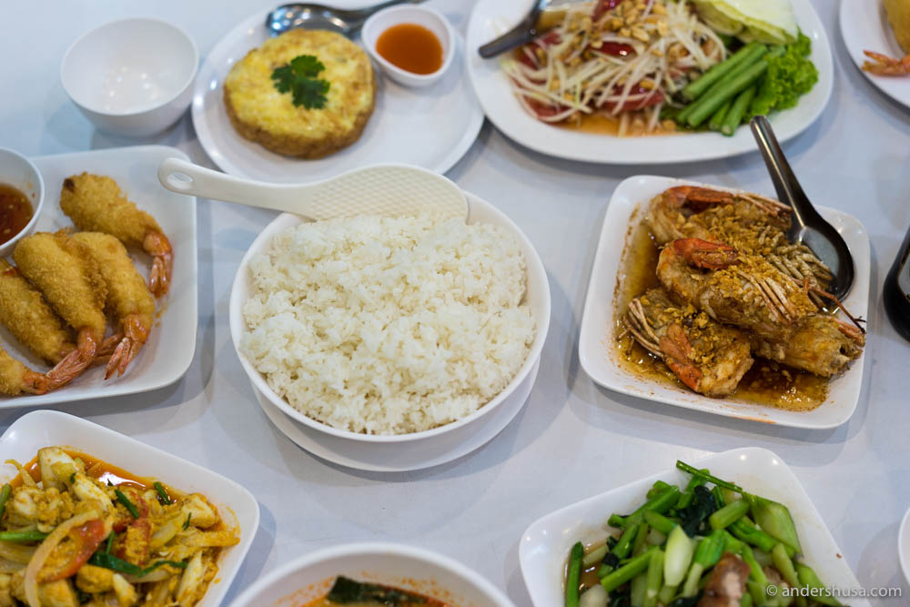 The table at Krua Apsorn covered in food, as it should be in Thailand.