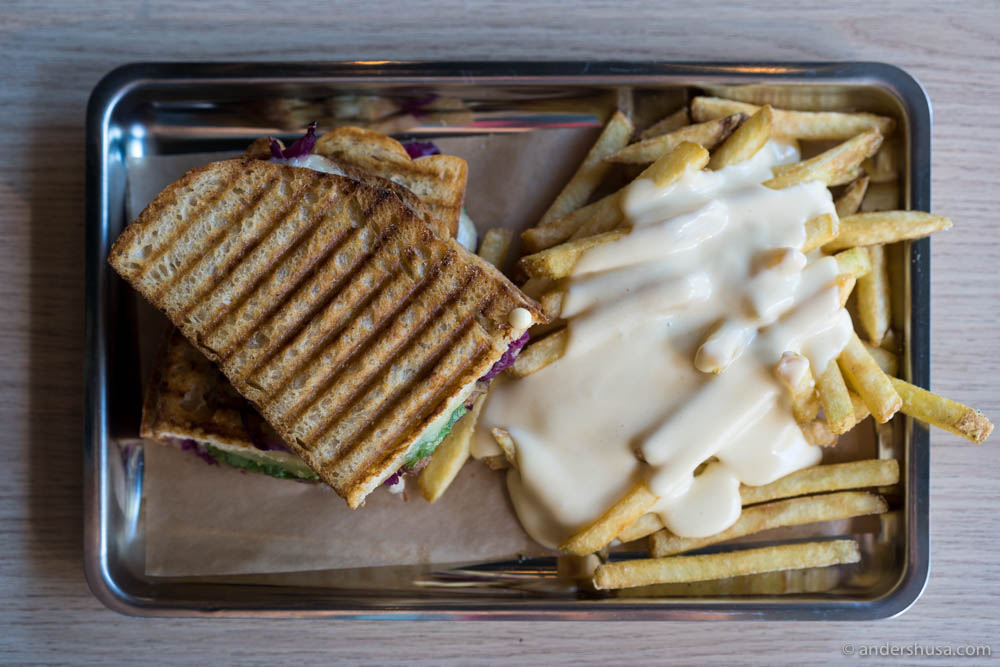 Korean Pork sandwich with fries and cheesy sauce