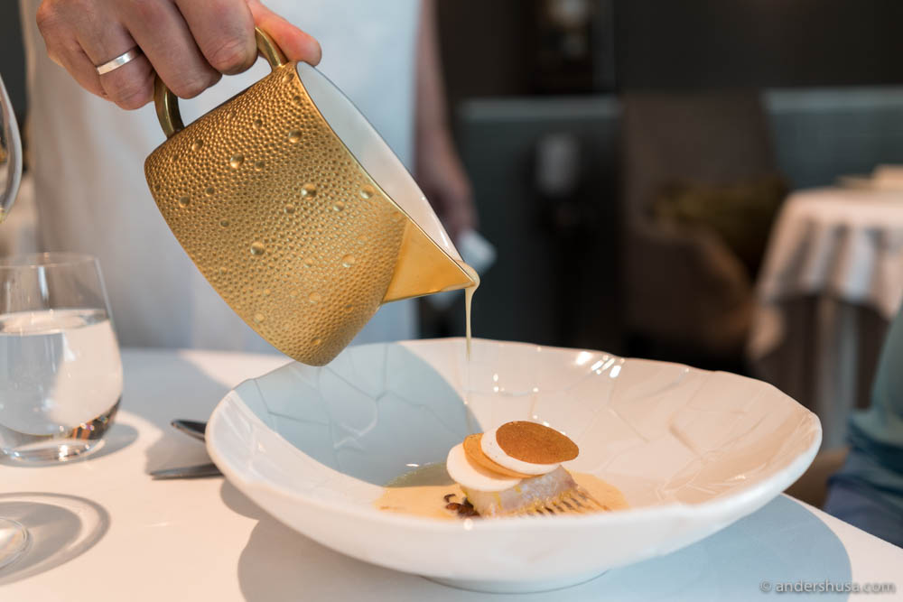 Sole carré getting a sauce aromatique served tableside from a beautiful pitcher