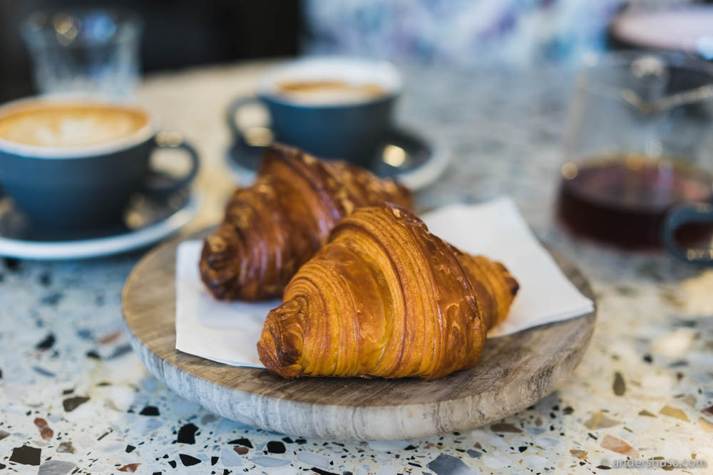 Original and espresso-glazed croissants