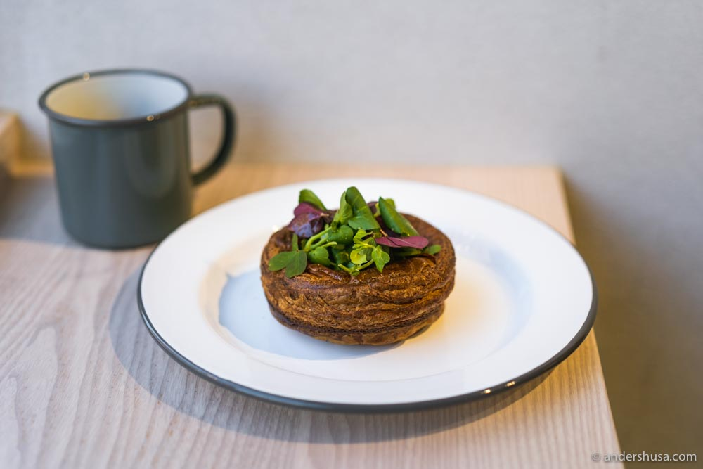 """The """"salad bowl"""" is a puff pastry filled with a mushroom bechamel sauce, topped with fresh herbs and a vinaigrette."""