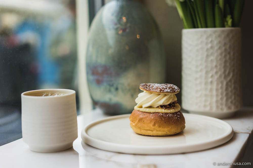 Traditional Swedish semla. Sweet roll with almond filling and whipped cream