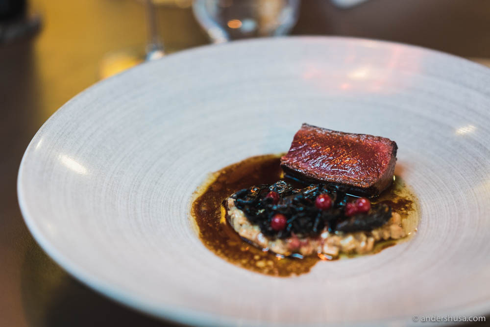 Perfectly cooked reindeer sirloin with ceps mushrooms, lingonberries, smoked reindeer heart, and a sauce mounted with brown butter at no. 14 – Tango in Stavanger, Norway.