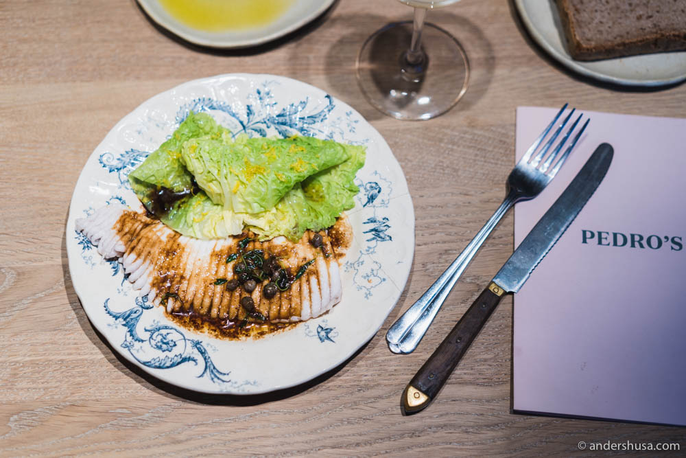 Skate wing with savoy cabbage, lemon zest, brown butter and soy sauce with capers at no. 22 – Pedro's in Oslo, Norway.