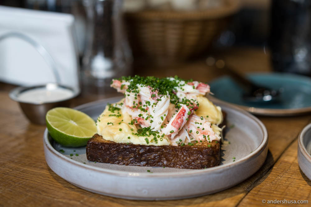 Buttery brioche toast with fluffy scrambled eggs topped with juicy and sweet king crab at no. 23 – Gorynych in Moscow, Russia.