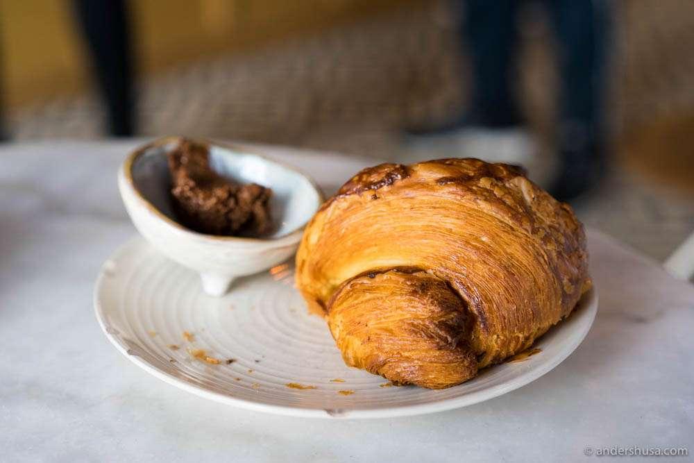 Flaky croissant with hazelnut spread