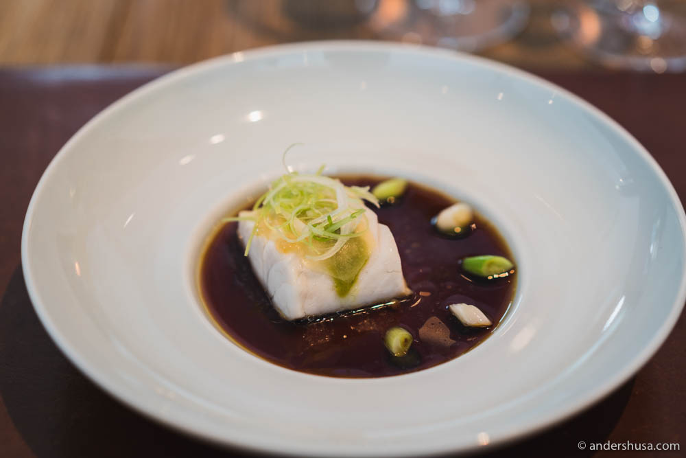 Steamed pike perch, a stock of 10 years aged kamebishi soy sauce, spring leek & young pickled ginger