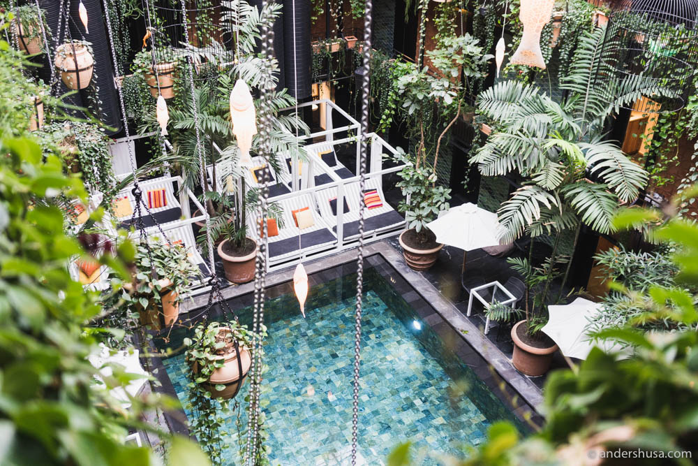 The courtyard garden with an indoor swimming pool at Manon Les Suites