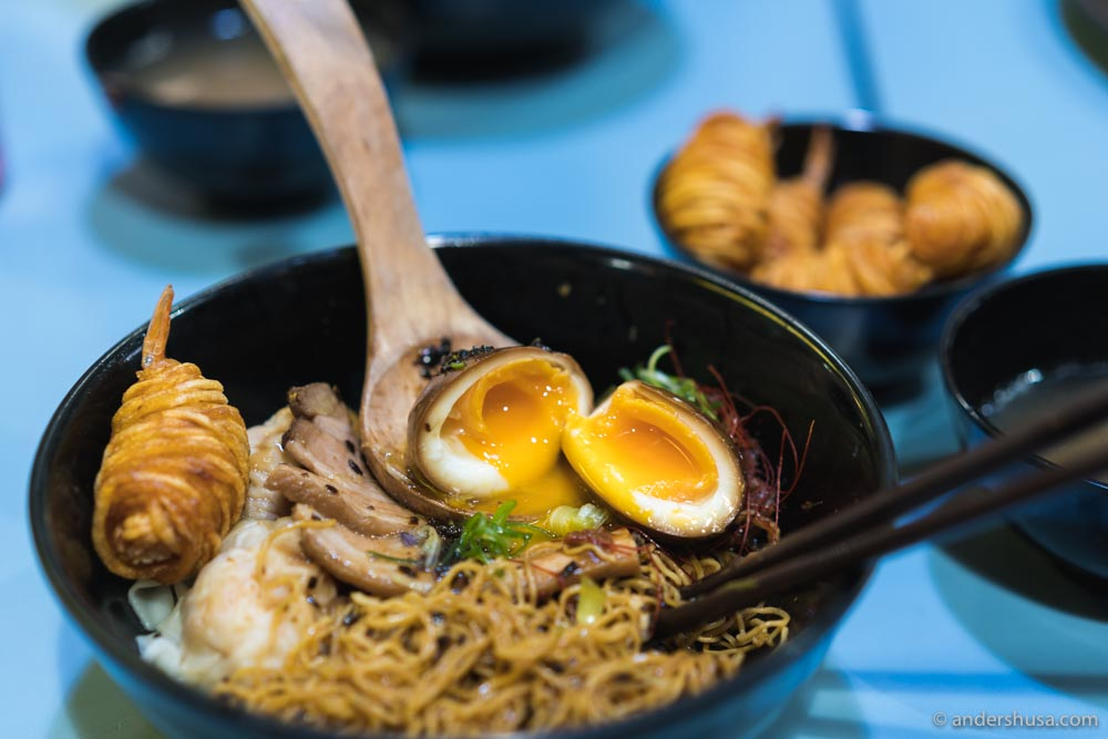 A Noodle Story serves a Singapore-style ramen with less broth than a typical Japanese ramen ...