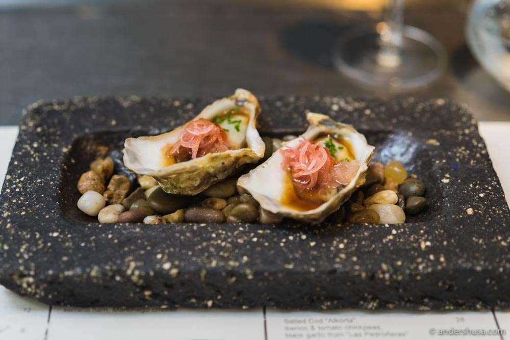 Tsarskaya oyster, jalapeño ponzu, salmon roe & pickled ginger flower.