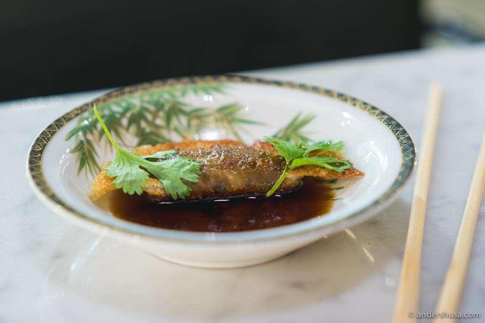 Gyoza with mushroom filling and ponzu glaze.