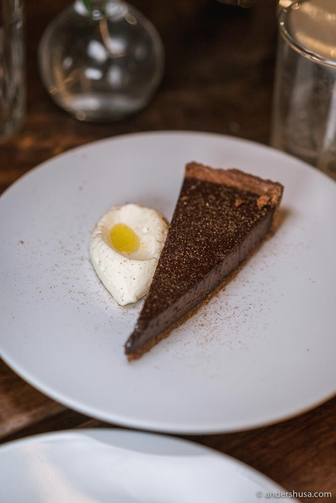 Chocolate tart, toasted coriander & yuzu ginger cream.