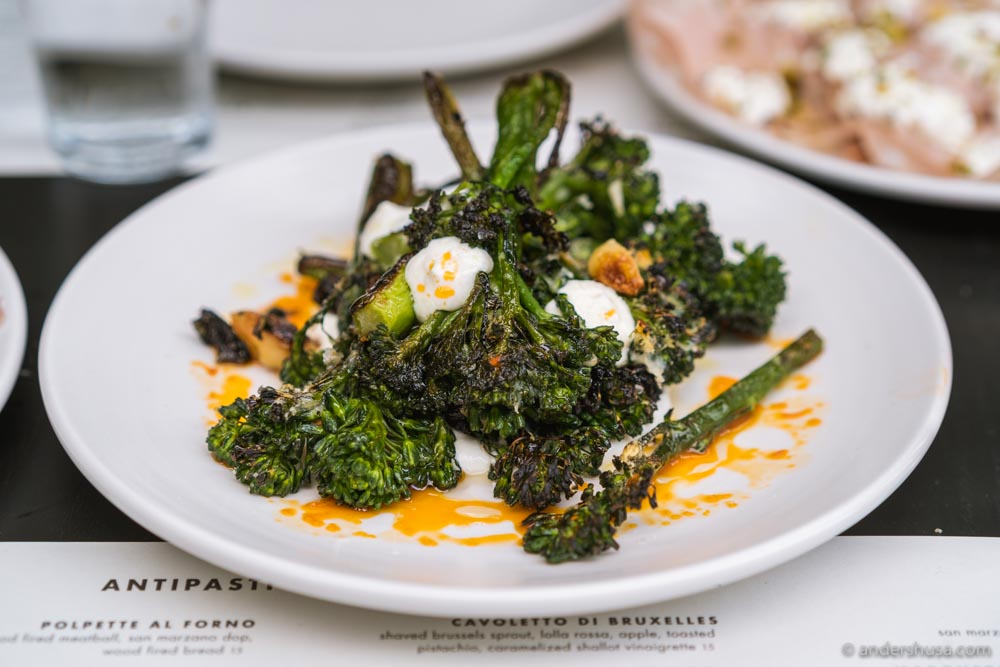 Pizzana's broccolini with whipped ricotta and chili oil.