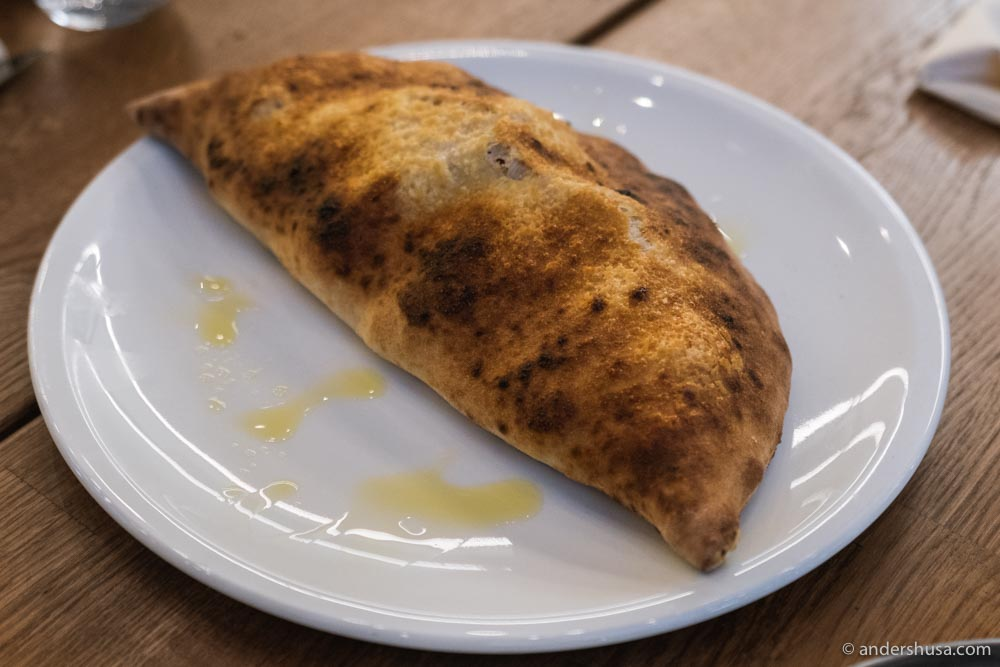Calzone – oven-baked folded pizza.