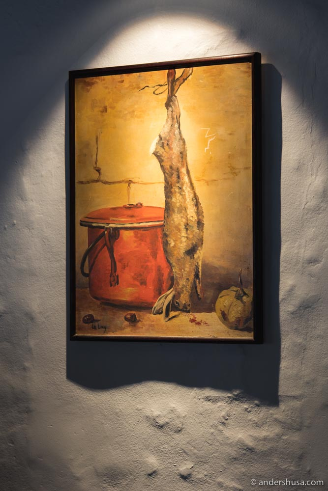 A painting by Chef Yves' father hangs on the wall.