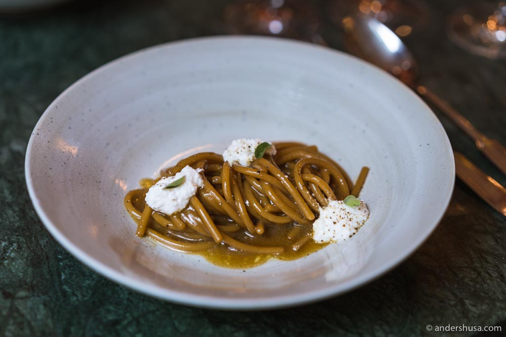 Spaghetti with roasted courgette jus and goat milk ricotta.