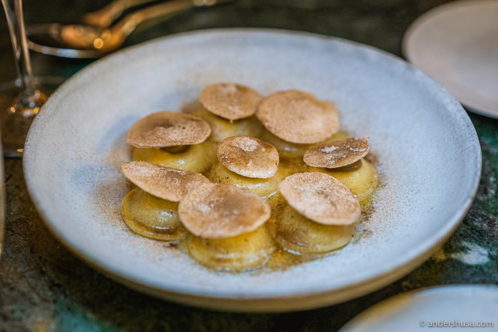 Ravioli filled with liquid Parmesan cheese and topped with a champignon mushroom.