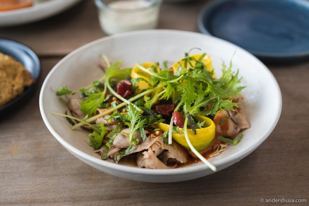 Smoked, shaved pork with plums, mustard, and garden herbs