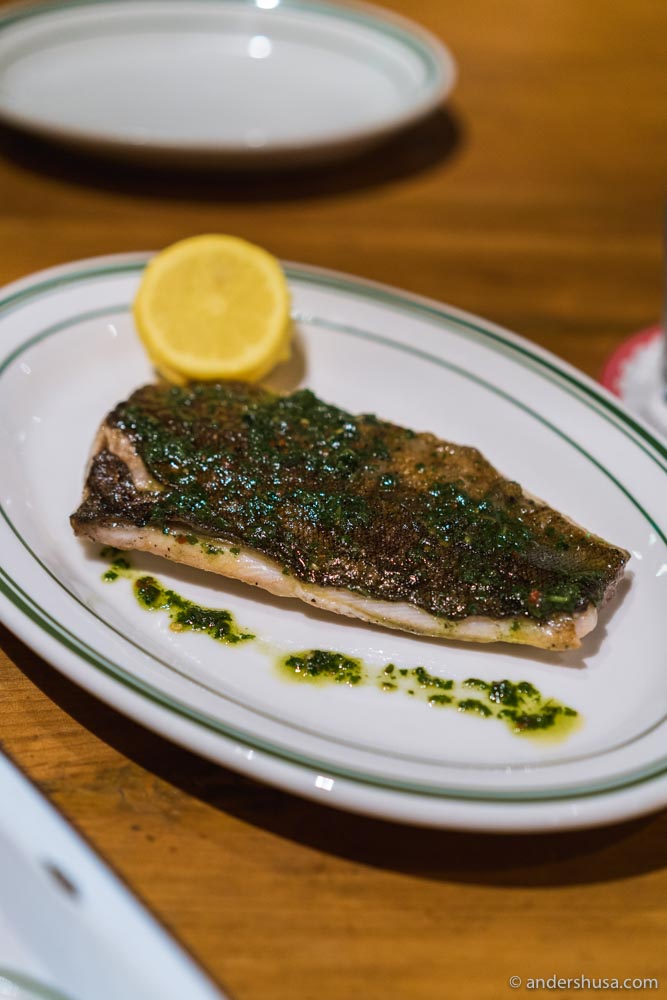 Grilled catch of the day with herb oil.
