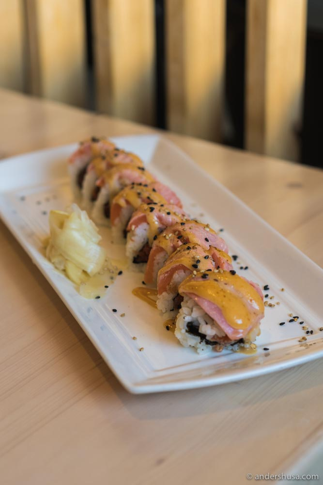 The Iki Roll – spicy tuna roll topped with seared salmon, spicy mayo, and sesame dressing.