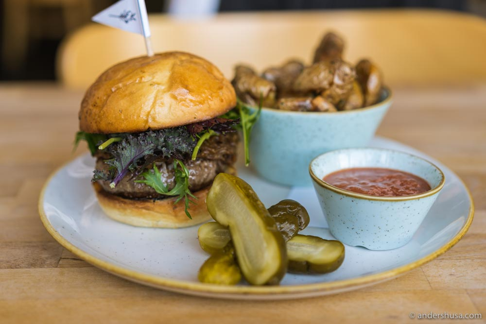 Kali's Dry Aged Beef Burger with fiscalini cheese, caramelized onions, and crispy fingerling potatoes.