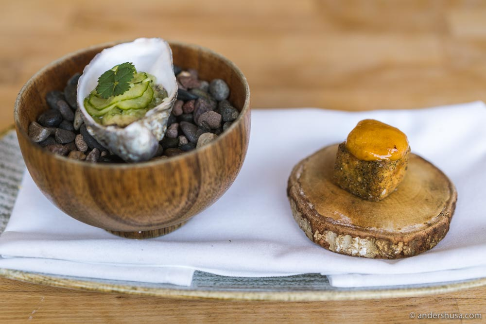 Amuse bouche –an oyster, and a crispy polenta cake dusted with local kale, and topped with sea urchin.