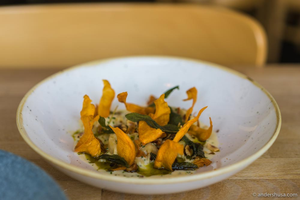 Parsnip agnolotti with sheeps milk cheese, sage, and hazelnuts.