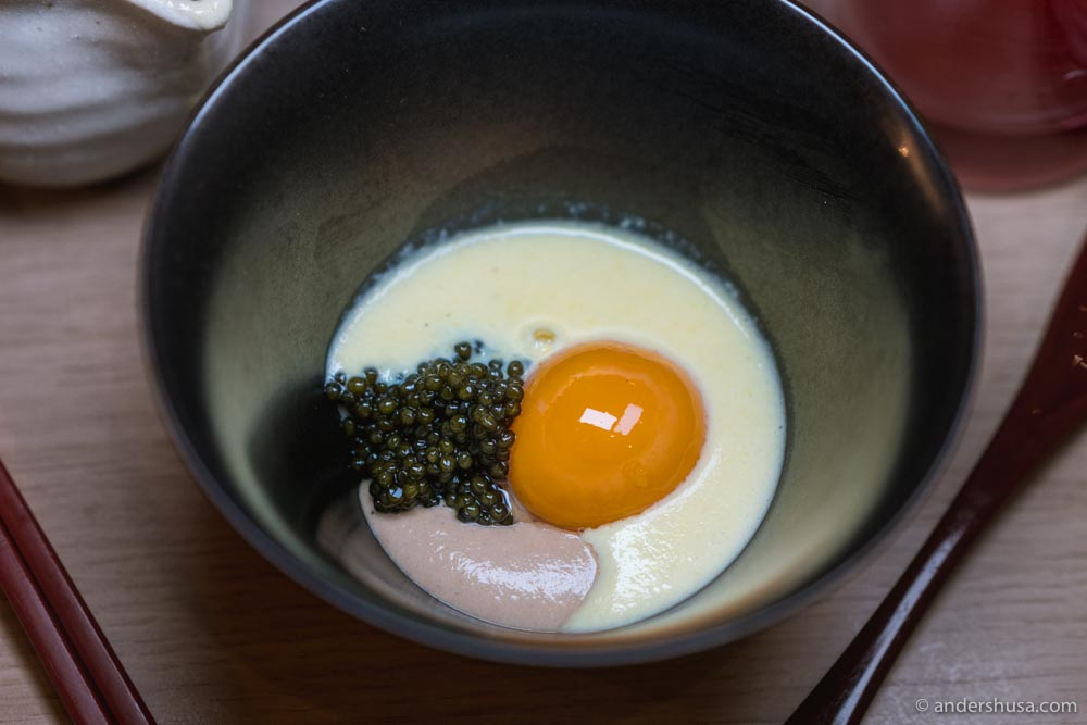 Kaluga caviar, onion cream, egg yolk, and corn soup.