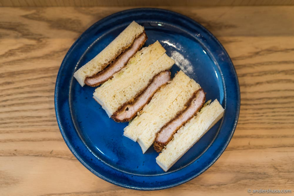 Pork katsu sandwich with cabbage and bulldog sauce.