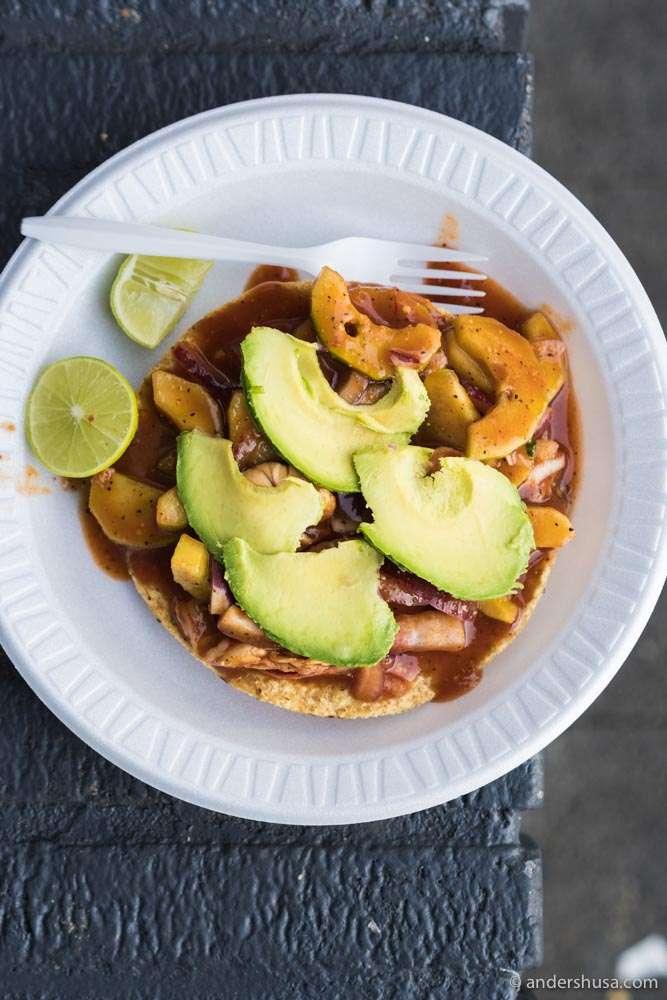 Aguachile – a crispy tostada, topped with shrimp, cucumber, and avocado.