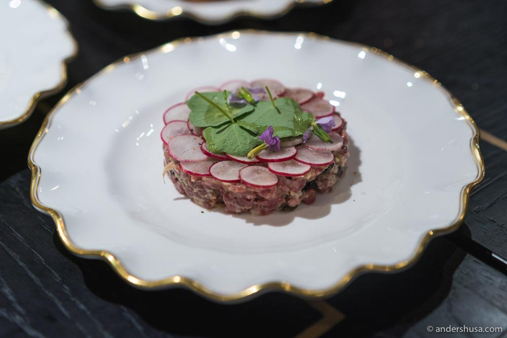 Pasjoli's beef tartare, topped with radishes and nasturtiums.