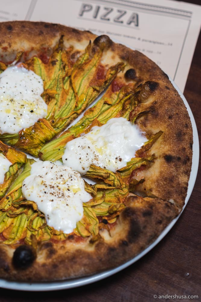 The squash blossom pizza with burrata and tomato.