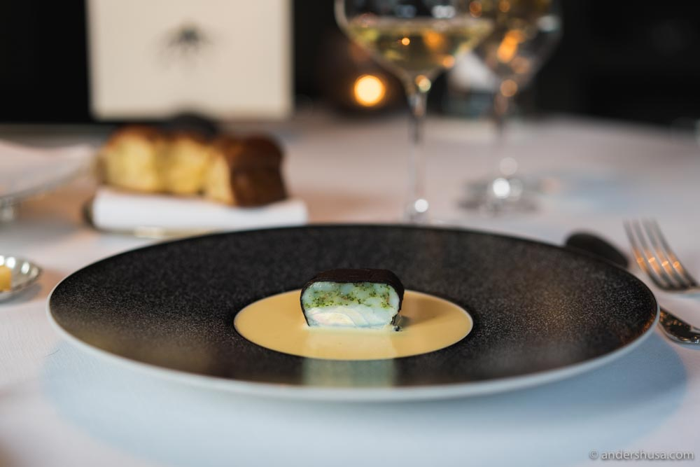Turbot, shiso, and langoustine, wrapped in truffle, with a beurre blanc sauce