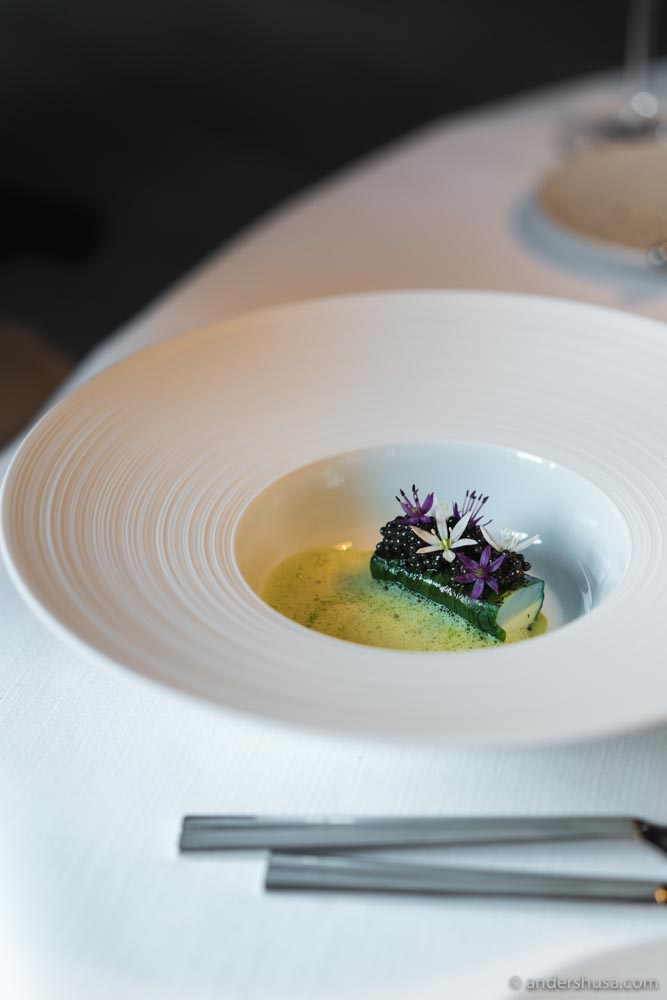 Sander, wrapped in ramson, topped with caviar and onion flowers